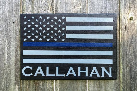 Thin Blue Line American Flag/Police Officer Gift/Retirement Gift/Law Enforcement/Graduation Gift/Personalized Police Sign/Home Decor  This would make a great gift any time of the year! It can be given for a Graduation gift, birthday, Valentines Day, Christmas, Police Week, Thank You, wedding, or anniversary gift for a police officer, sheriff, deputy, state trooper, or any law enforcement officer or first responder  Demensions are: 16 x 11  Colors: Black background, Blue Line, Gray Stripes…