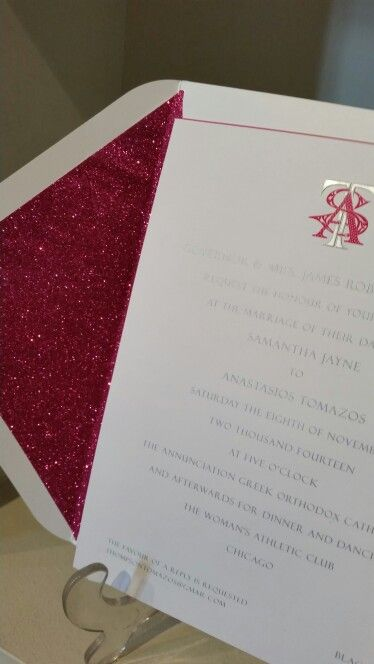 Hot pink glitter lining to match the pink monogram of this wedding invitation