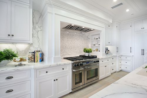 Carrera marble kitchen and white cabinetry