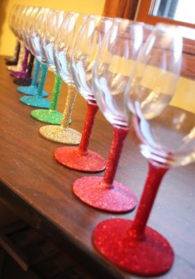 Another awesome shot of DIY glitter stems on wine glasses. This one has a better tutorial + must try on our LED light up cocktail glasses: http://www.flashingblinkylights.com/frostedledwineglasswithclassyblackbase-p-2780.html