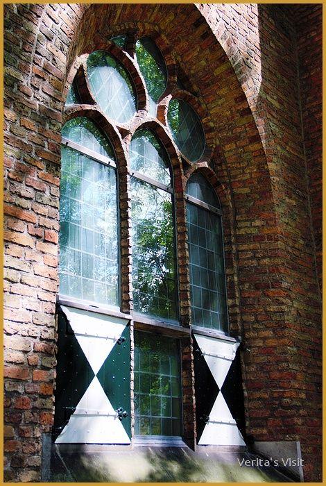 Reflection in window museum Prinsenhof Delft