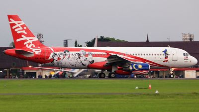 AirAsia (MY) Airbus A320-214 9M-AFP aircraft, painted in ''1 Malaysia'' special colours Dec. 2012, skating at Indonesia Adisutjipto International Airport. 20/02/2017. (1 Malaysia=an ongoing programme designed by Malaysian Prime Minister Najim  Tun Razak on 16/09/10 calling for the cabinet,government agencies & civil servants).