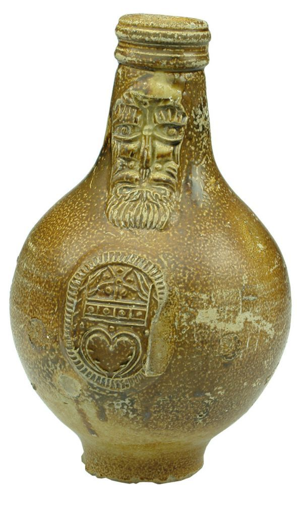 Auction 26 Preview | 867  | Bellarmine Heart Shield Stoneware Jug  JCS Caloric Punch; Vieux Cognac; B.M.I Tonic Wine. Some wear, scratches and marks.  SOLD $1,185.00