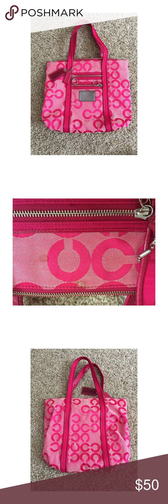 "Coach Poppy Pop Art Glam tote Authentic (serial number can be verified by calling Coach customer service)  Large pink tote in good used condition. There are a few spots on the outside of the bag that a dry cleaner or purse specialist would most likely be able to remove (shown in the two close up pics). Inside lining is clean with multiple inside pockets for keys, phone, etc.  price reflects the age and condition.   Measurements are: 16 3/4""L x 12 1/4""H x 4""W 20"" handles with a 8 1/2"" drop…"