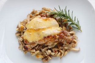 Pork Chops with Rosemary: This recipe is cooked in two stages: the chops are flash-fried in a pan, then finished more slowly in the oven.Towards the end of cooking, you can top the meat with slices of cheese, if you like.
