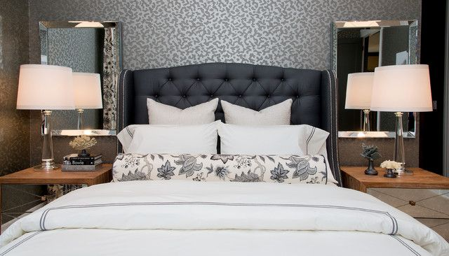 Atmosphere Interior Design: Glamorous gray master bedroom with dark gray tufted headboard. The bed is dressed with ...