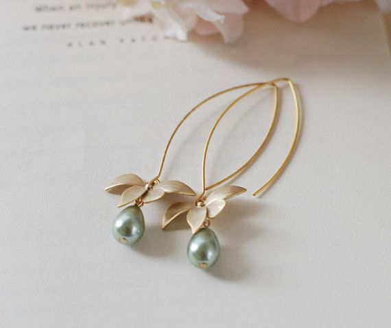 Sage Green Pearls Gold Orchid Flowers Long Dangle Earrings. Sage Green Wedding Earrings. Bridesmaid Gift. Lovely matte gold flowers are hung from gold plated long oval hook ear wires with 9mm x7mm sage green Czech teardrop glass pearls dangling beneath.  Total length of these earrings is approx. 2.5 (64mm) including the long oval hook ear wires. These earrings with cream white pearls (last picture) are available here:  www.etsy.com/listing/220345111/bridal-pearl-earrings-wedding-pearl…