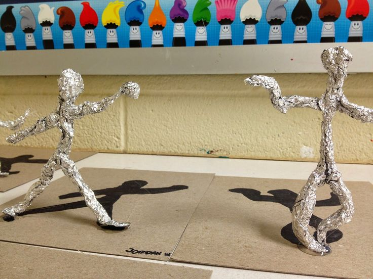 Foil gesture drawing with shadow. It could be a good tie-in with a Keith Haring project. The foil looks like it is hot glued on the cardboard. Students make a few gesture drawings first and then choose 1 to create the foil sculpture from.