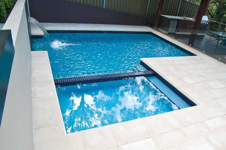 The geometric design of this saltwater plunge pool works well for the kids whilst providing a dry space for adults to lounge while supervising swimmers.