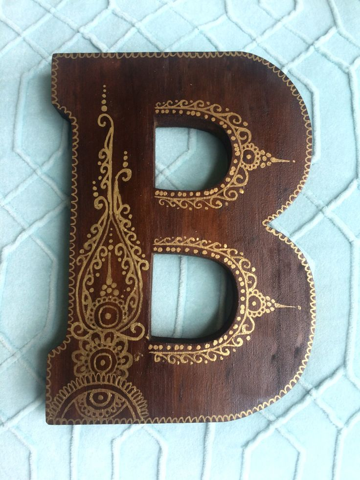 Decorated Wooden Letter - Dark Stain, Gold Paint by DesignsByBlaire on Etsy https://www.etsy.com/listing/244822663/decorated-wooden-letter-dark-stain-gold