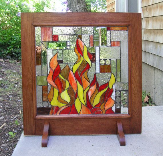 Geometric Mission Style Fireplace Screen with Wooden Frame 31 wide x 31 tall This is an original fireplace screen design. The flames of the