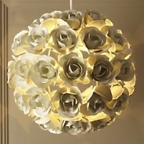Rose lampshade. Could this be a DIY project ??..........Make paper roses and glue them onto a paper lantern light fixture.