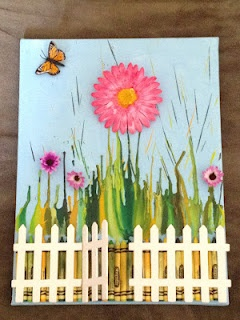 Melted Crayon on Canvas - Love the painted background and having the crayons on the bottom as part of the fence!  I also like the added dimensions of the flowers and butterfly being glued on.