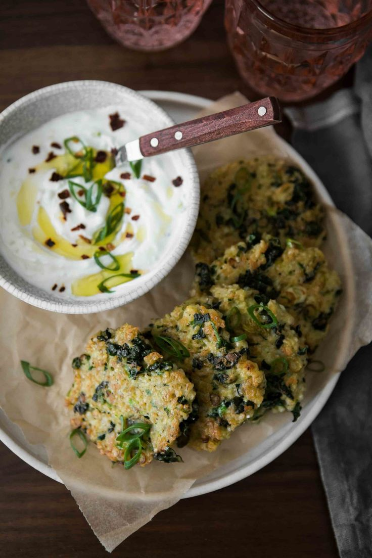 Easy bulgur fritters with greens and an easy garlic yogurt. Perfect for lunch or a light dinner. Plus, they come together quickly with thanks to the quick cooking bulgur.