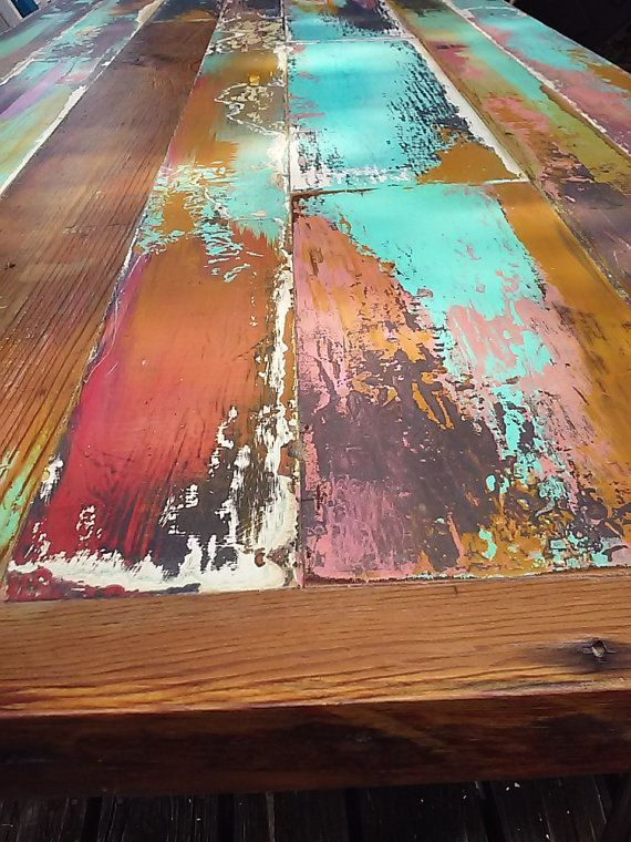 imagine the conversation and the new memories happening around a this dining center piece made from vintage doors from antique homes in the Kansas City area! Layers of color enhance the original patina. the door knob holes are filled to level but the history is visibly imprinted in the wood under the color and sealers. Then the table top is centered over an industrial-style frame made from black or galvanized plumbing pipe. if you like this finish, and want to spend less on your table top, i…
