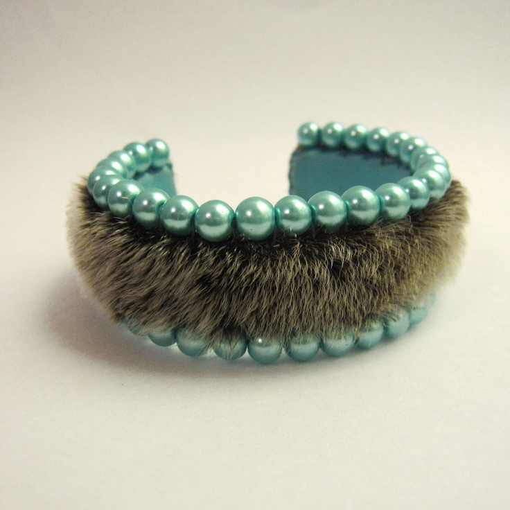Unexpected sealskin and blue pearls combo by Beyond Buckskin Boutique