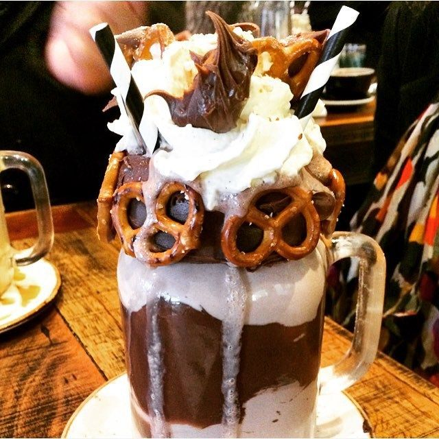 YAS. FREAK-SHOW MILKSHAKE. Giant jar of NUTELLA and Salty Pretzel milkshake at 10am this morning. Heavily laden with Nutella, topped with a mountain of vanilla bean whipped cream, and more Nutella with salty pretzel. #Nutellaholic #patissez #Canberra #canberrabrunch #patissezcanberra #nutellaporn #freakshowshake