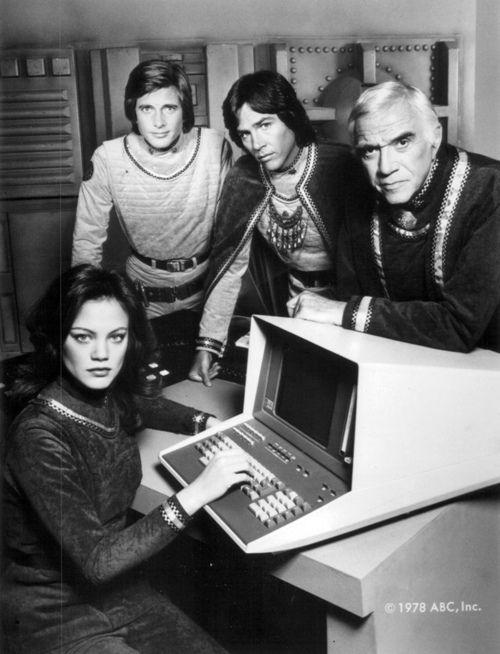 The cast of the original Battlestar Galactica  (1978): Dirk Benedict, Richard Hatch, Lorne Greene, and Maren Jensen.