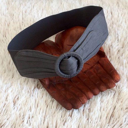 5€ Cinturón Springfield. Cinturón gris de Springfield tipo fajín.De tela y la parte de atrás de goma para adaptarse mejor al cuerpo y a cua