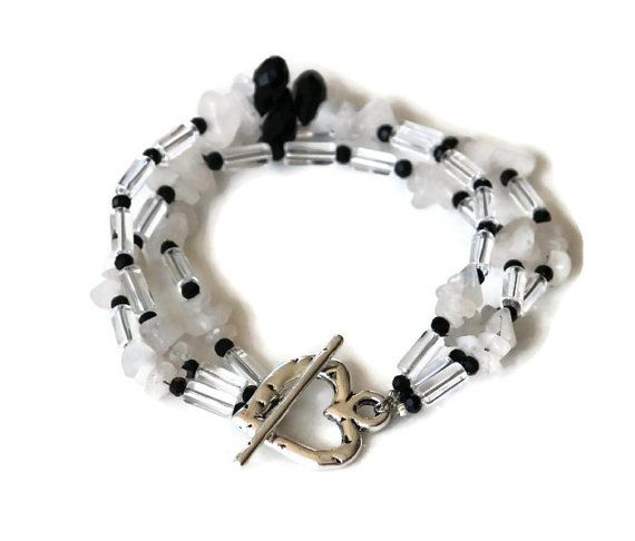 Black and white multi strand bracelet by HeartBeads.  https://www.facebook.com/heartbeadsjewellery