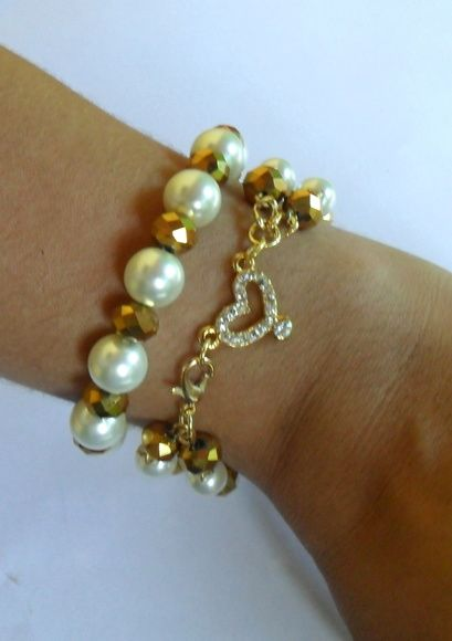Conjunto+de+pulseiras++1+pulseira+de+perolas+e+cristais+ajustável+1+pulseira+de+perolas+e+cristais+19+cm R$ 28,00
