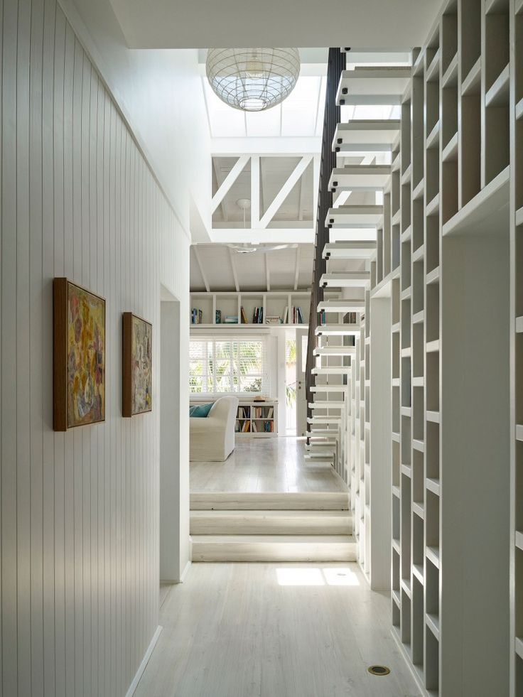 Beach House On Stilts by Luigi Rosselli Architects | timber panelling and bookshelves |© Justin Alexander