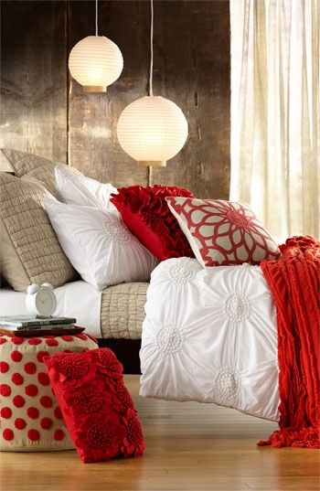 Rustic bedroom interior with pops of red.