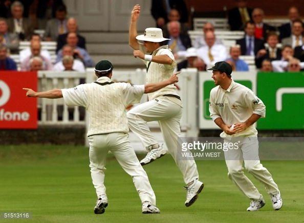 News Photo : Australian fielder Mark Waugh celebrates catching...