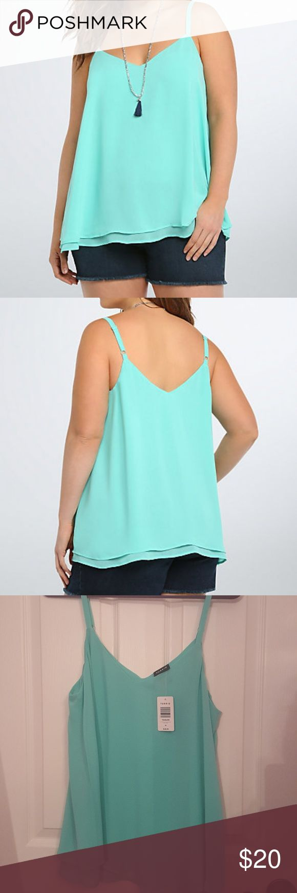 Torrid chiffon top size 00 new with tags This mint green cami is doubling down with a sexy v-cut front and back. Cut with two floaty, semi-sheer, and swingy chiffon layers, this cami is a dressy upgrade from your everyday tanks. Torrid Tops
