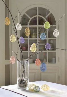 Easter Tree with branches and stones from the backyard and DIY string eggs.