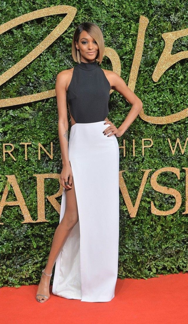 Jourdan Dunn wears a black and white cutout gown with metallic heels