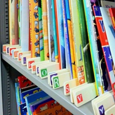 Use paint sticks and alphabet stickers to organize by authors' last names