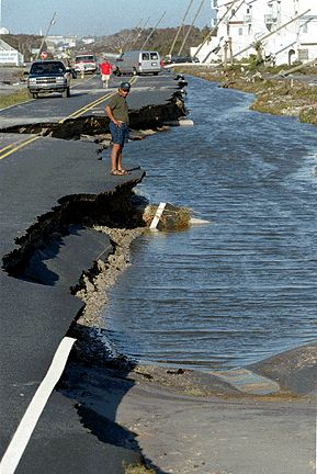 Flooded Road  Tom Sais looks over state road 1568 at North Topsail Beach N.C. on Saturday July 13 1996. The island suffered extreme utilities damage and loss of sand dunes. The island is expected to stay closed for several days.