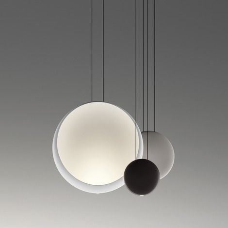 Cosmos Cluster 2511 Pendant Light by VIBIA | Composed of several lacquered thermoplastic discs suspended at varying heights, Cosmos creates the appearance of satellites orbiting a moon.