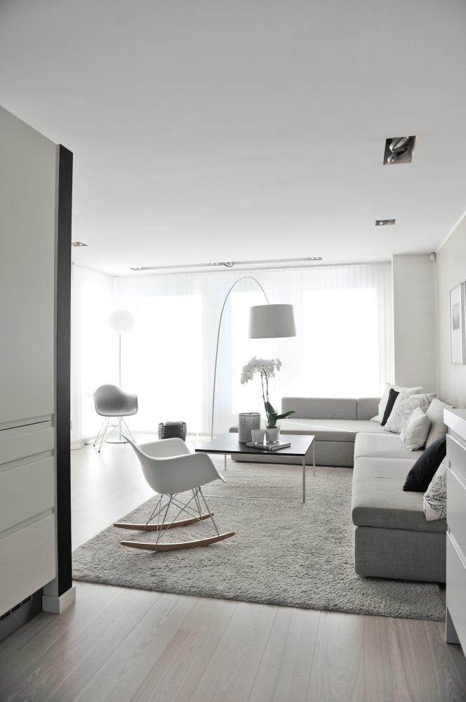 grey rocking chair lamps lighting sofa white carpet