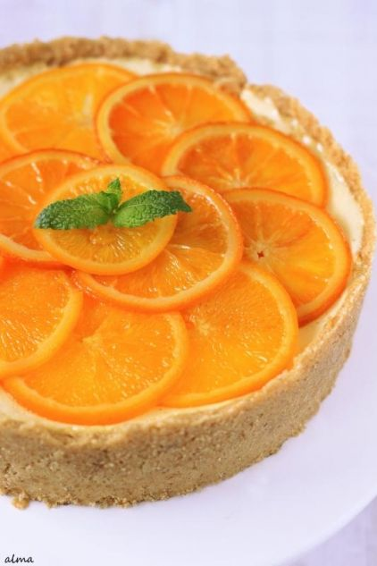 Ingredients: 6 egg yolks 125 gr  of sugar 375 gr  of double cream, 35% fat content 70 ml of orange juice grated rind of one orange 4 sheets of gelatin 3 pelargonium leaves, finely chopped 1 layer of honey cake, 25 cm diameter and 4 cm high  To decorate 3 slices of orange 2 pelargonium leaves,chopped