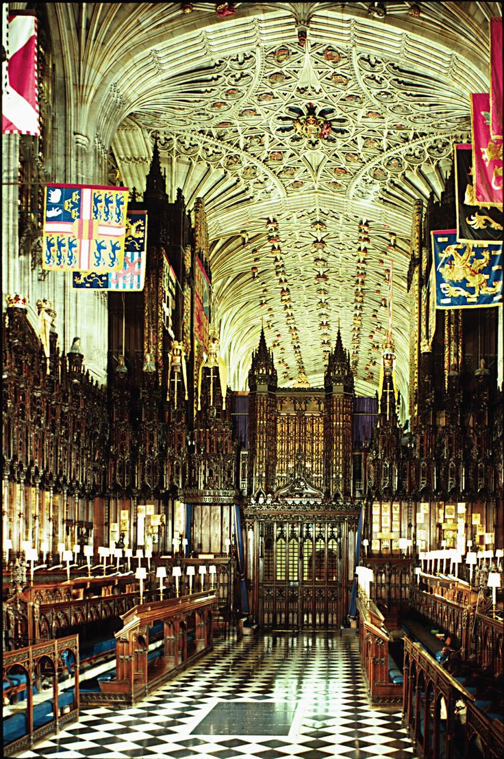 Saint George's Chapel  The interior of the Chapel has a beautiful ceiling, carved   wooden stalls, and the flags of the Knights of the Garter.   (photo by: Woodmansterne Limited Watford, UK)