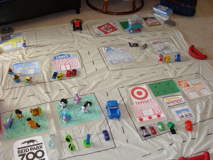 DIY playmat from shower curtain.  can make a map of your city, places you go!  I want to do this for spencer