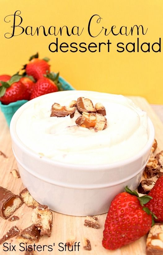 Banana Cream Dessert Salad from SixSistersStuff.com.  A creamy banana cream pudding with strawberries and candy bar pieces! YUM! #recipes #dessert #salad