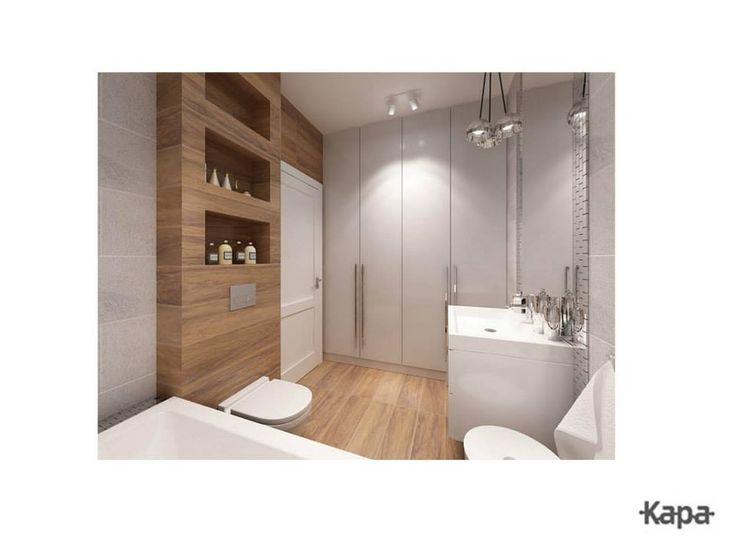 Kapa Studio - drewno-podobna płytka na podlodze  i częściowo ścianie, duże szafy