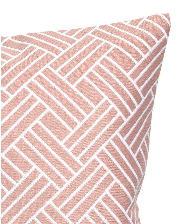 Dusky pink. Cushion cover with a jacquard-weave pattern at front and solid-color woven cotton fabric at back. Concealed zip.