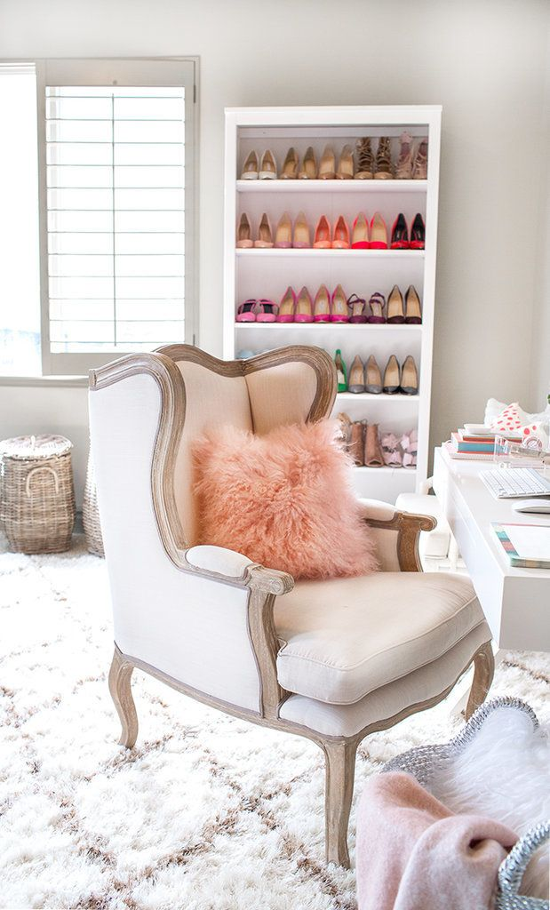 A fluffy and feminine home office with a stocked shoe shelf
