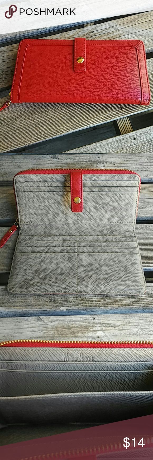 Neiman Marcus Red Wallet Gently carried.  Gold hardware. 12 credit card slots.  Purchased new from Neiman Marcus.  One small pen for on inside.  I believe this is simulated leather.  However, stunning! Neiman Marcus Bags Wallets