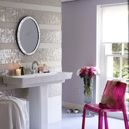 Striped tiling - If you'd like your bathroom to feel light, airy and glamorous, take a cue from this chic space tagged on We Heart It. Here are some tips for creating this look on a budget. Skip the mosaic tiles and instead paint a white wall with horizontal stripes in a silver metallic or pearlescent finish. Z Gallerie's Devon Mirror is similar in style to the one here.