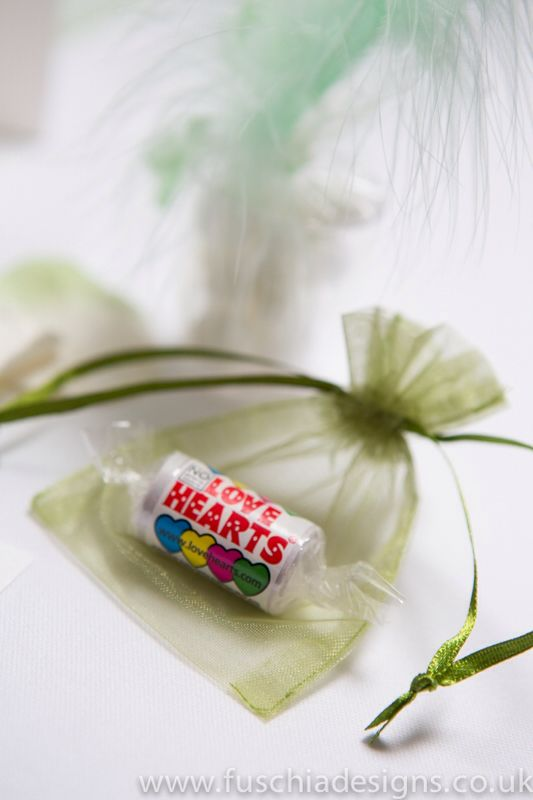 Green voile bag with love heart roll of sweets wedding favour £1.25 each. www.fuschiadesigns.co.uk