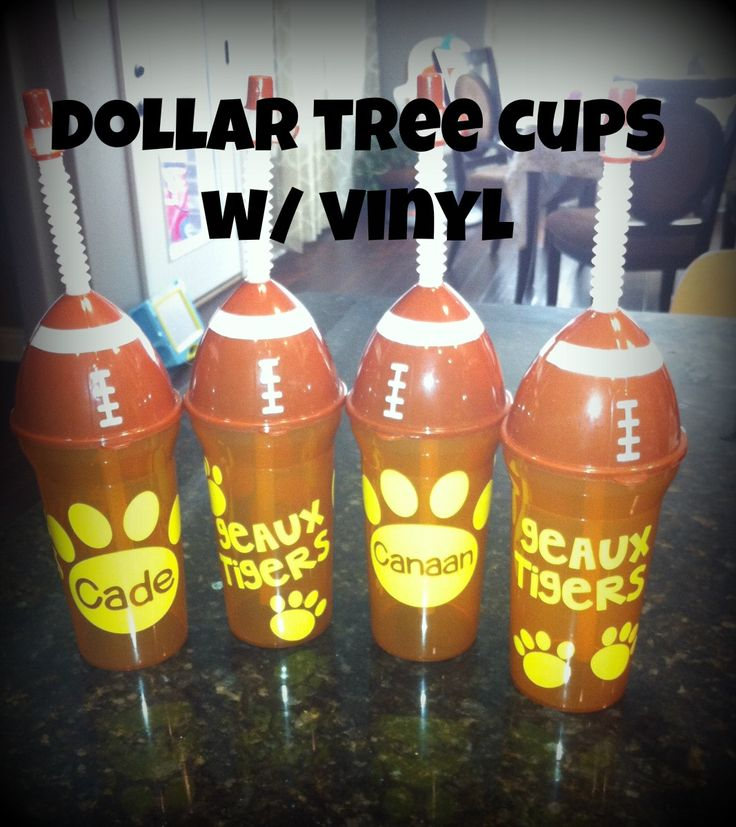 Dollar tree cups with vinyl for my little guys LSU themed first birthday party :0)