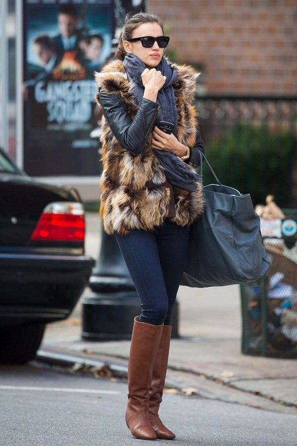 Irina Shayk on the street in New York - celebrity fashion - Irina Shayk is all over winter chic, scoring a major DO in a (faux - we hope) fur gilet, skinnies and leather riding boots.
