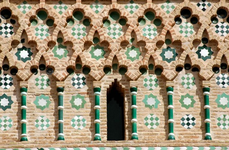 Teruel mudejar- San Martin Tower. Teruel. Spain. - The Mudéjar style, a symbiosis of techniques and ways of understanding architecture resulting from Muslim and Christian cultures living side by side, emerged as an architectural style in the 12th century on the Iberian peninsula.