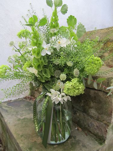 Floral Arrangement ~ Bells of Ireland are a great, affordable spring flower for home designs!