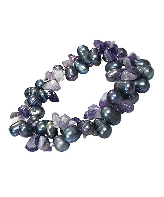 Amethyst & Pearl Double-Strand Stretch Bracelet. - .  REL Jewelers. - .  $9.99 Compare at $50.00  . Product Description:  This double-strand stretch bracelet boasts freshwater pearl and amethyst accents for earth-inspired style.      0.5'' W  .     Freshwater pearl / amethyst  .     Imported